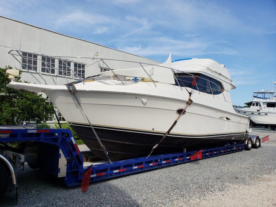 Silverton 34C, boat shipping, boat haulers, boat transport, boat transport pros, boat hauling service